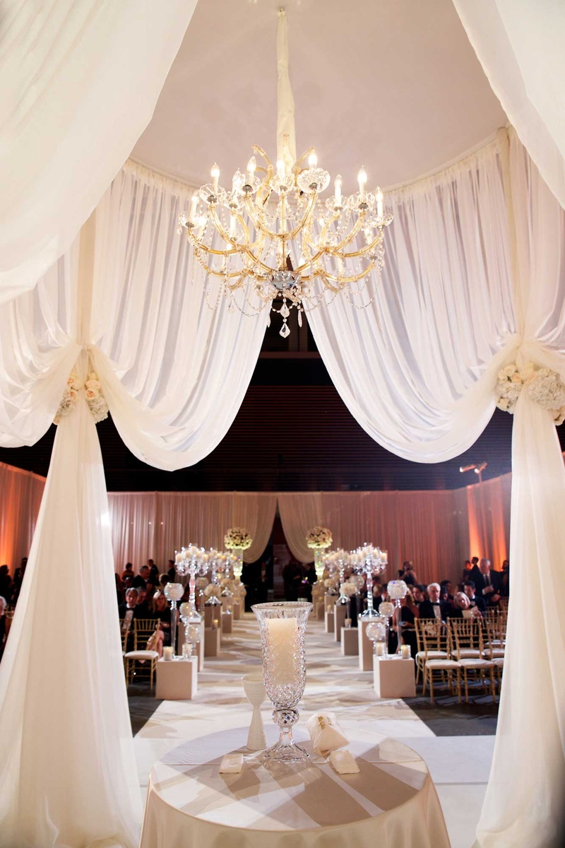 Wedding Ceremony Structure With Ivory Dry Flower Tiebacks And Crystal Chandelier