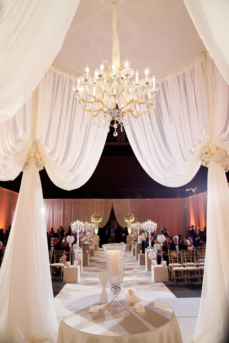Million dollar listing miami star chad carrolls cleveland wedding wedding ceremony structure with ivory drapery flower tiebacks and crystal chandelier aloadofball Choice Image