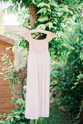 flower girl dress cap sleeves details blush hanging up garden outside english wedding british