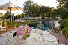 Round tables and wood chairs around pool