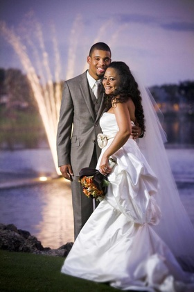 Groom in grey suit with Haitian and Lebanese bride at sunset