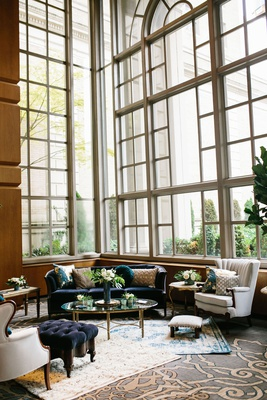 wedding styled lounge tufted velvet furniture teal and gold details fairmont olympic hotel seattle