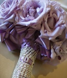 Purple rose wedding bouquet with crystal wrap
