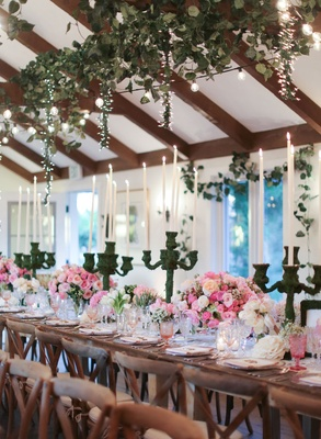Wedding reception at San Ysidro ranch with moss candelabra pink rose ranunculus wood tables