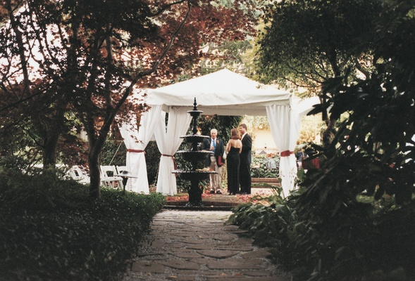White Ceremony Structure Surrounded By Trees