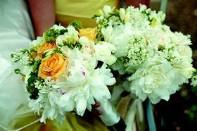 Nosegays featuring white, green, and orange flowers
