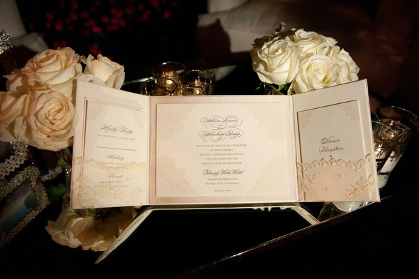 Wedding invitation with flower motif and delicate lace