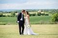 Bride in a Berta Bridal gown kisses groom in a navy Ralph Lauren tuxedo on a Pennsylvania field