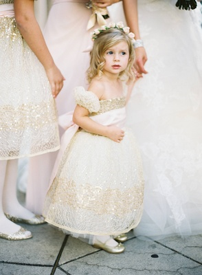 Blonde flower girl with gold and white sequin dress