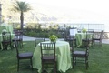 Oceanfront bluff with green cocktail tables and apple centerpiece