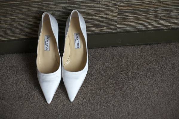white pointy-toe Jimmy Choo pumps