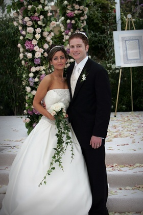 Newlyweds at outdoor Jewish marriage ceremony