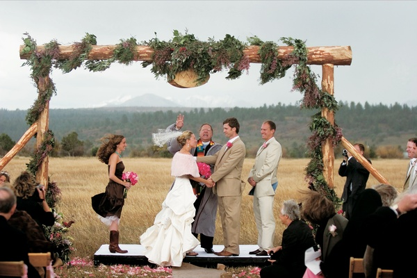 Windy outdoor ceremony with wooden altar