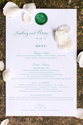 White and green menu design with wax seal swan motif and Southern favorites