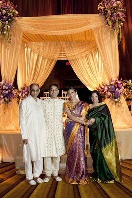 Actress Reshma Shetty, groom, and her parents at her Indian Hindu wedding