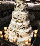 five layer wedding cake with fondant flower appliques