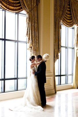 The Breakers ballroom bride and groom embrace
