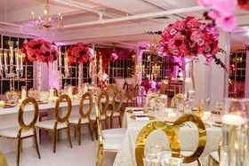 Wedding reception all white ballroom with candles candelabra pink fuchsia flower centerpieces