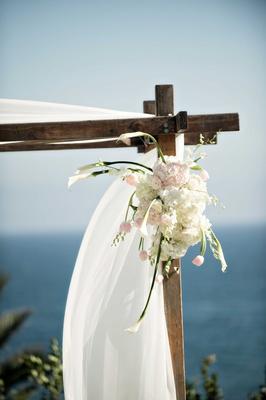blush ivory green arrangement ceremony arch outdoor california wedding bel-air bay club long stemmed