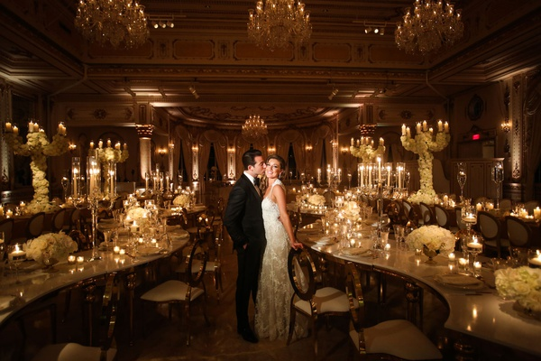 wedding reception at the mar a lago club formal bride and groom serpentine tables candles white