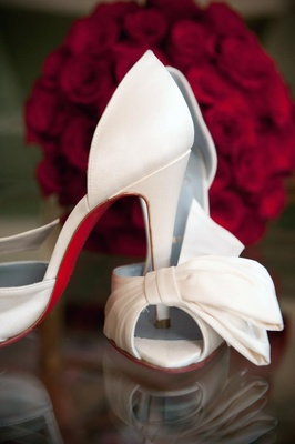 Christian Louboutin heels with half-bow