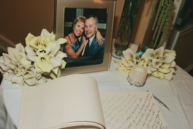 Signed guest book with calla lily bouquets and candles
