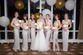 bride in monique lhuillier, bridesmaids in silver ralph lauren gowns, new year's eve wedding