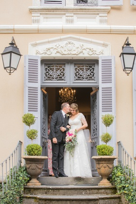wedding ceremony processional father of bride giving daughter kiss before wedding outdoor france