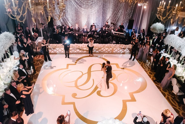 Wedding reception dance floor white and gold monogram oversized dancing reception white flowers
