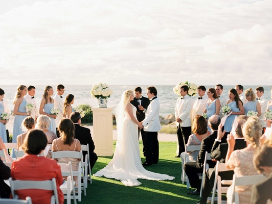 Sanibel and Captiva Island wedding ceremony grass lawn white riser blue white compote vase hydrangea
