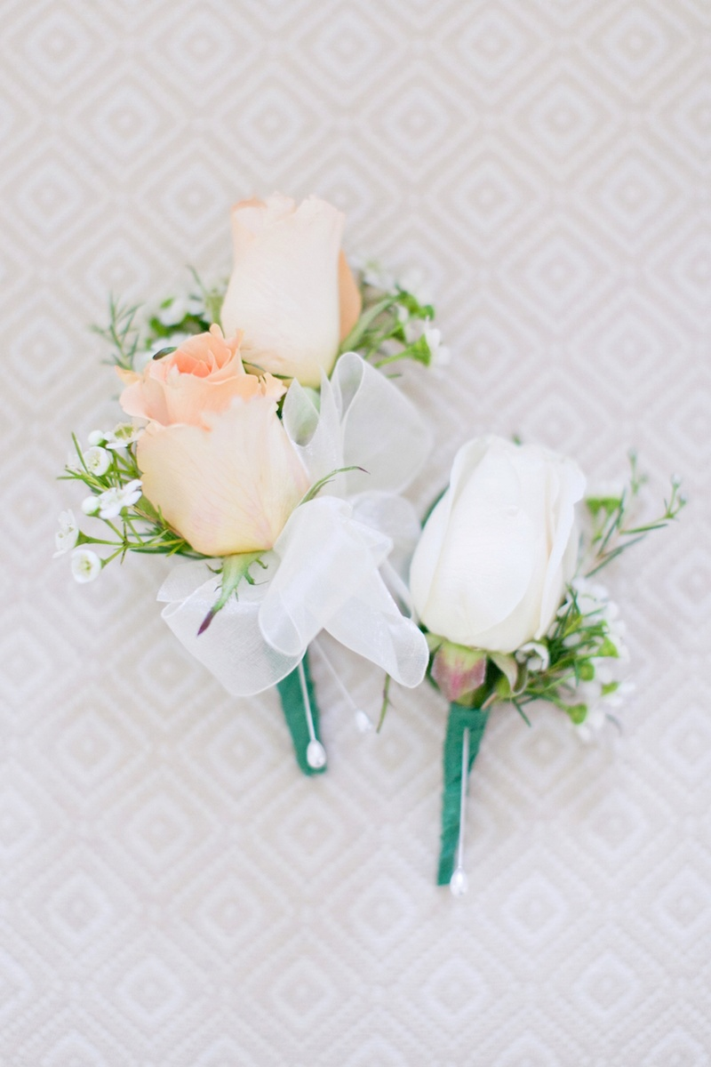 boutonnieres photos - white & peach rose boutonnieres - inside