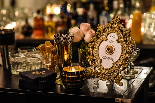 gold and black decor wedding bar intricate gold frame with bell for champagne