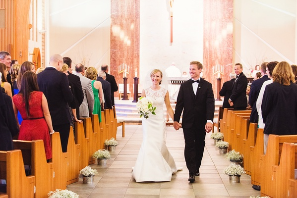 couple walks up aisle after ceremony