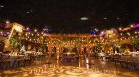 Indoor ballroom wedding reception at unique venue in Indiana light patio lights gobo projection