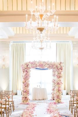 wedding ceremony casa del mar ivory drapery chandelier pink rose petals lining aisle chuppah gold
