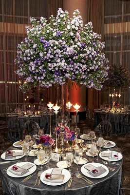 Tree-like purple flower centerpiece at wedding reception