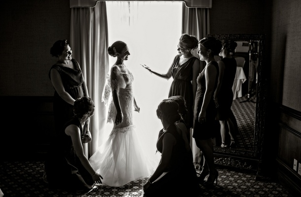 bride in Marchesa bridal gown getting dressed