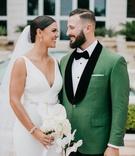 wedding portrait bride and groom miami florida v neck wedding dress green tuxedo jacket black lapels