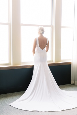 back view of crepe silk dress by allure with open back and train