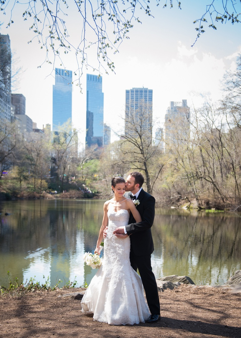 a bride and groom embracing in new york city's central park during their first look before ceremony