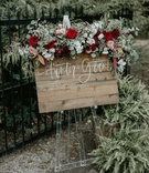 wedding reception welcome sign wood sign on clear lucite stand burgundy flowers greenery amaranthus