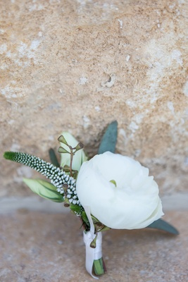 Groom's boutonniere white flower buds and greenery white ribbon
