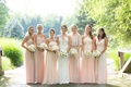 bride in pronovias gown with illusion neckline lace bodice, mismatched bridesmaids in blush