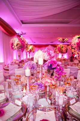 Fuchsia orchid and mercury glass candleholders at wedding