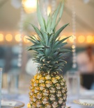Hawaii wedding on island of Maui fresh pineapple wedding decorations on table centerpiece reception