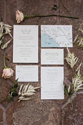 Wedding invitation suite white stationery light blue seafoam color letterpress monogram map