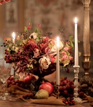 renaissance inspired tablescape in palace in florence, fall colors, berries, pears, pomegranates
