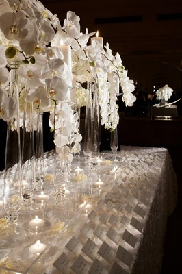 Elegant seating card table with white orchids
