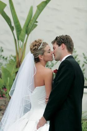 Newlyweds kiss and embrace
