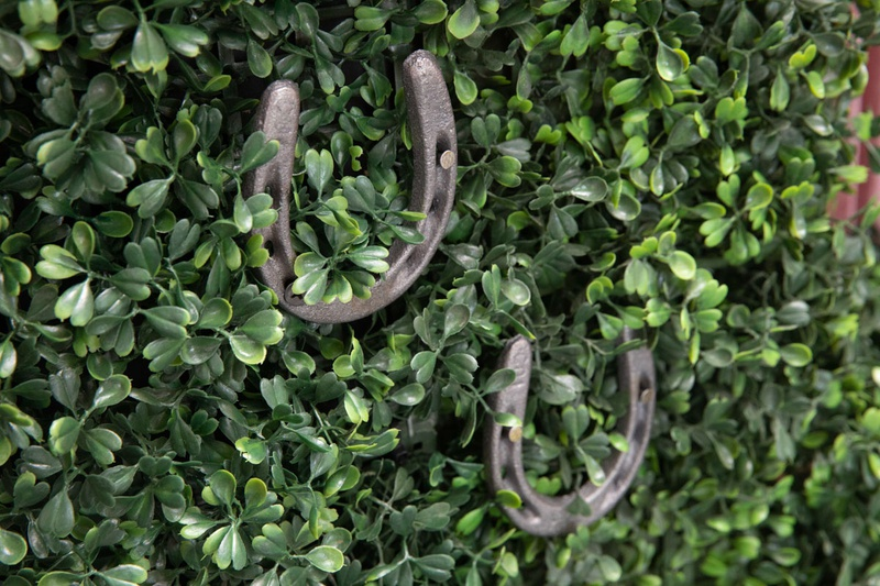 kentucky derby themed bridal shower, boxwood hedge wall with two horsehoes